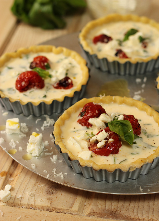 Tricolore tartelettes with balsamic cherry tomatoes, feta & rocket